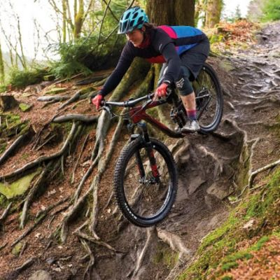 """BikeRadar found that the Intrigue Advanced """"places the rider in an aggressive yet comfortable position, which encourages experimentation with bigger, badder trail features."""" Photo courtesy BikeRadar.com"""