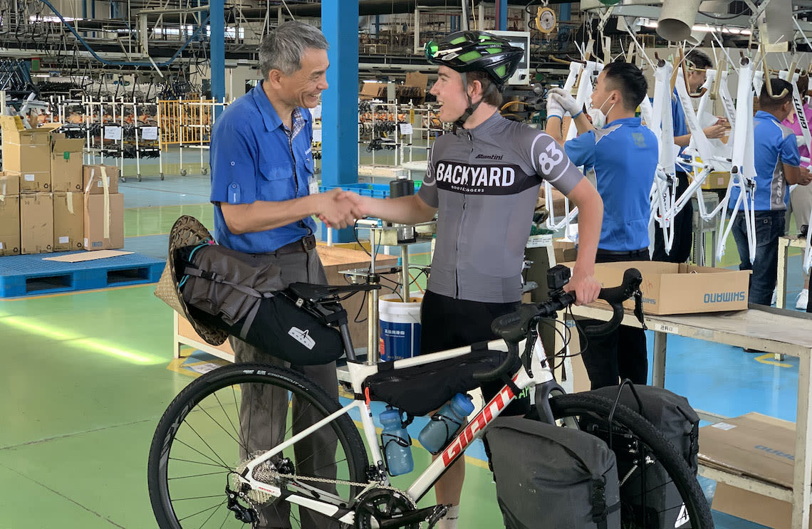 Giant ambassador Josh Reid picks up a new Revolt gravel bike from the Giant factory in China