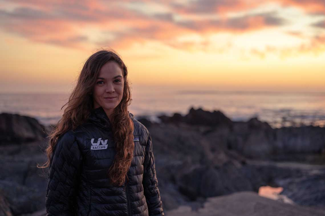 Sarah Hill smiling outdoors at sunrise